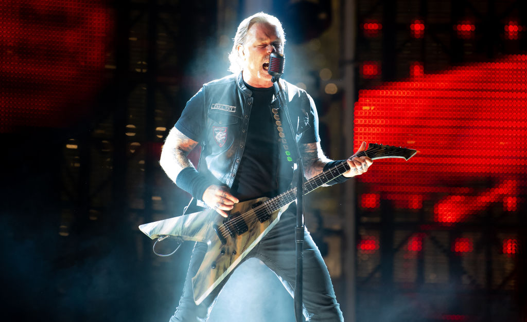 """James Hetfield, front singer of the US metal band Metallica, stands on stage in the Olympic Stadium. The band performs as part of their """"World-Wired-Tour"""". Photo: Sven Hoppe/dpa (Photo by Sven Hoppe/picture alliance via Getty Images)"""